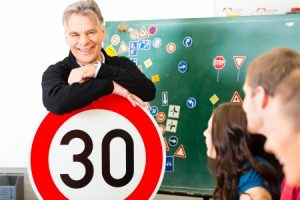 driving instructor and student drivers